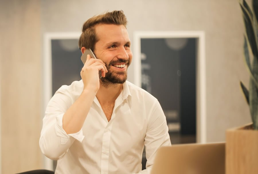 man interviewing inspector on phone